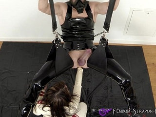 Rubber nurse anally fists her male slave