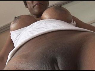 Busty mature ebony babe in tight spandex cameltoe tease